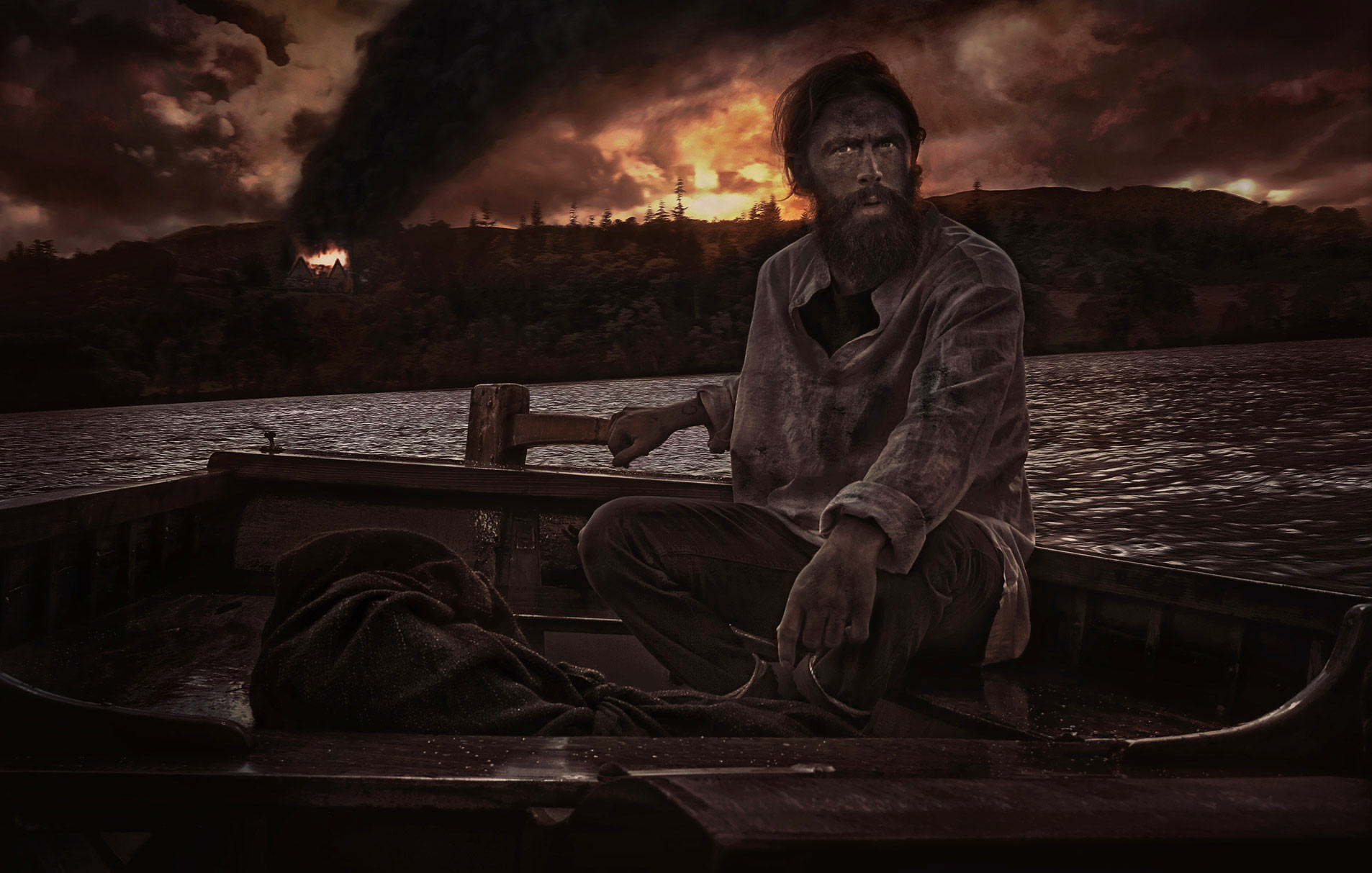 Bearded Man escapes in a boat at night. Burning building in the background.
